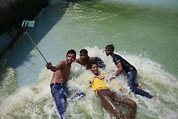May 5, 2017 - Dhaka, Bangladesh - Bangladeshi children take photo with their cell phone while take bath in the polluted water of a lake at Dhaka, Bangladesh, May 5, 2017. Temperature in Dhaka reached 39 degrees Celsius on 5th May. (Credit Image: © Suvra Kanti Das via ZUMA Wire)