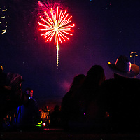 Fireworks illuminate a crowd at the Gallup Sports Complex during the annual Fourth of July Party in the Park Monday in Gallup.