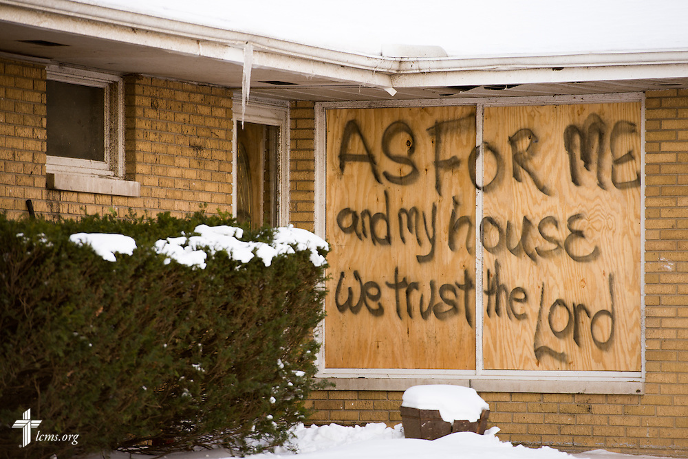 A sign is attached to a home in a damaged neighborhood of Washington, Ill., on Wednesday, Dec. 18, 2013. Nearly two dozen tornadoes plowed through Illinois in November, killing a total of seven. LCMS Communications/Erik M. Lunsford