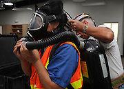 Mining engineering student, Myra Dobar, (left), suits up in rescue equipment during training at the San Xavier Mining Laboratory Training Center, University of Arizona, Tucson, USA.
