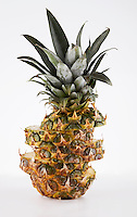 Pineapple cut in slices over white background