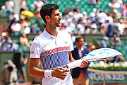 Novak Djokovic (SRB) takes out a new racket during the preliminary rounds of the Roland Garros Tennis Open 2017 at Roland Garros Stadium, Paris, France on 2 June 2017. Photo by Jon Bromley.