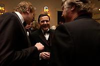 """20 NOV 2003, NEW YORK/USA:<br /> Gerhard Schroeder, SPD, Bundeskanzler, im Gespraech mit Spitzenvertretern der Wirtschaft, waehrend einem Empfang vor einer Festveranstaltung des American Institute for Contemporary German Studies anl. der Verleihung des """"Global Leadership Awards"""" Hotel Grand Hyatt at Grand Central<br /> IMAGE: 20031120-03-020<br /> KEYWORDS: Gerhard Schröder, U.S.A., Reise, Smoking<br /> Gespräch"""