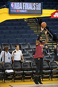 May 30, 2018; Oakland, CA, USA; Cleveland Cavaliers forward LeBron James shoots the basketball during NBA Finals media day at Oracle Arena.