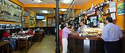 Locals in traditional Spanish Tapas Raciones bar in Bilbao, Spain