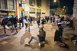 © Licensed to London News Pictures . Manchester , UK . 05/04/2015 . A man pushes himself up off the pavement on Withy Grove in Manchester City Centre . Revellers on a Saturday night out during the Easter Bank Holiday weekend . Photo credit : Joel Goodman/LNP