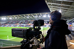 SWANSEA, WALES - Monday, January 22, 2018: A television cameraman before the FA Premier League match between Swansea City FC and Liverpool FC at the Liberty Stadium. (Pic by David Rawcliffe/Propaganda)