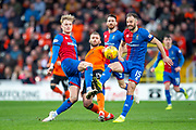 Pavol Safranko (#14) of Dundee United FC is sandwiched between Coll Donaldson (#5) and Sean Welsh (#15) of Inverness Caledonian Thistle FC during the William Hill Scottish Cup quarter final match between Dundee United and Inverness CT at Tannadice Park, Dundee, Scotland on 3 March 2019.