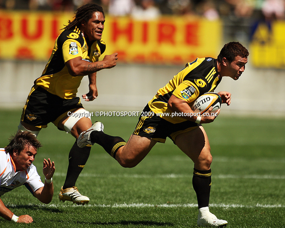 Hurricanes flanker Karl Lowe has captain Rodney So'oialo in support as he escapes the ankle-tap of Hanno Coetzee.<br /> Super 14 rugby union match, Hurricanes v Cheetahs at Yarrows Stadium, New Plymouth, New Zealand. Saturday 7 March 2009. Photo: Dave Lintott/PHOTOSPORT