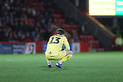 James Montgomery reacts to conceding 2 goals  during the EFL Sky Bet League 2 match between Cheltenham Town and Forest Green Rovers at LCI Rail Stadium, Cheltenham, England on 29 December 2018.