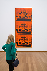Visitor looking at Friedrich Monument by Andy Warhol at Hamburger Bahnhof modern art museum in Berlin, Germany