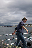 Man working on ferry leaving the Aran Islands in Galway Ireland