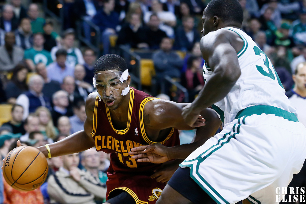 19 December 2012: Cleveland Cavaliers power forward Tristan Thompson (13) drives past Boston Celtics power forward Brandon Bass (30) during the Boston Celtics 103-91 victory over the Cleveland Cavaliers at the TD Garden, Boston, Massachusetts, USA.