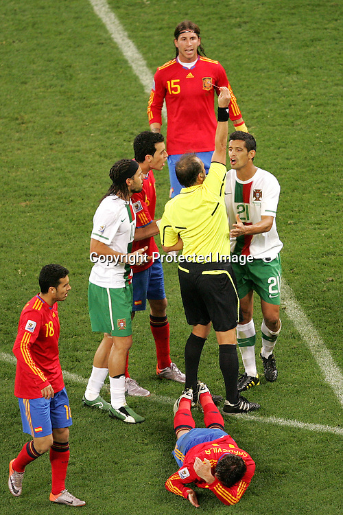 The Referee gives Ricardo Costa of Portugal a red card during the FIFA World Cup 2010 last 16 match between Spain and Portugal held at The Cape Town Stadium in Green Point, Cape Town, South Africa on the 29th June 2010<br /> <br /> <br /> Photo by Ron Gaunt/SPORTZPICS