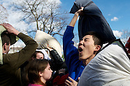 April 2, 2011 - A participant in International Pillow Fight Day raises his pillow ready to strike at the giant pillow fight that occured on Cambridge Common on Saturday. Photo by Lathan Goumas.