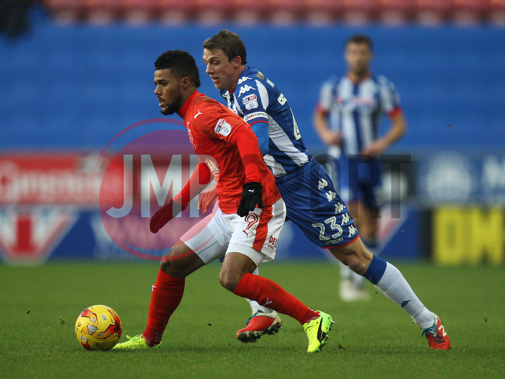 Elias Kachunga of Huddersfield Town (L) and Stephen Warnock of Wigan Athletic in action - Mandatory by-line: Jack Phillips/JMP - 02/01/2017 - FOOTBALL - DW Stadium - Wigan, England - Wigan Athletic v Huddersfield Town - Football League Championship