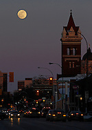 The moon rises behind the Young United Church tower along Broadway, Saturday, March 15, 2014. (TREVOR HAGAN/WINNIPEG FREE PRESS)