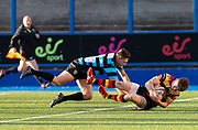 Carmarthen Quins' scrum half Aron Hemmings dives over to score the first try with less than two minutes on the clock.<br /> <br /> <br /> Cardiff Arms Park, Cardiff, Wales, UK - Saturday 19th October, 2019.<br /> <br /> Images from the Indigo Welsh Premiership rugby match between Cardiff RFC and Carmarthen Quins RFC. <br /> <br /> Photographer Dan Minto<br /> <br /> mail@danmintophotography.com <br /> www.danmintophotography.com