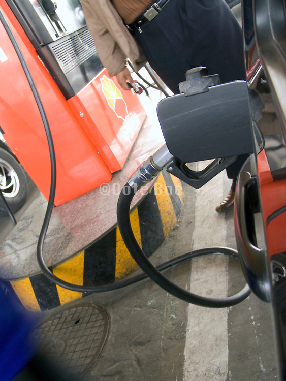 close up of a car filling up at a gas station