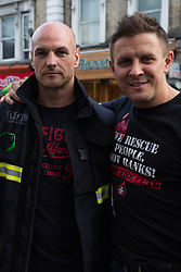 London, UK. 14th June, 2018. Firefighters Ricky Nuttall (c), who wrote a poem describing his experience of attending the Grenfell Tower fire, and Leigh Pickett (r) take part in the Grenfell Silent March through West Kensington on the first anniversary of the Grenfell Tower fire. 72 people died in the Grenfell Tower fire and over 70 were injured.