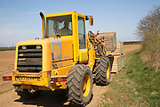 JCB Farm Master vehicle carrying boxes of seed potatoes to be planted in fields, Sutton, Suffolk, England, UK