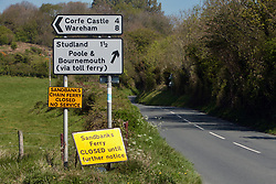 Covid 19 - road signs announcing the suspension of the Shell Bay to Sandbanks Ferry. The chain ferry a vital service to key workers traveling to Poole/Bournemouth/Christchurch from the Isle of Purbeck Dorset, withdrawn from service for lack of business, causing a 22 mile detour. Dorset UK April 2020