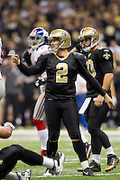 28 November 2011: Kicker (2) John Kasay of the New Orleans Saints kicks an extra point against the New York Giants during the first half of the Saints 49-24 victory over the Giants at the Mercedes-Benz Superdome in New Orleans, LA.