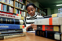 University student studying in library.