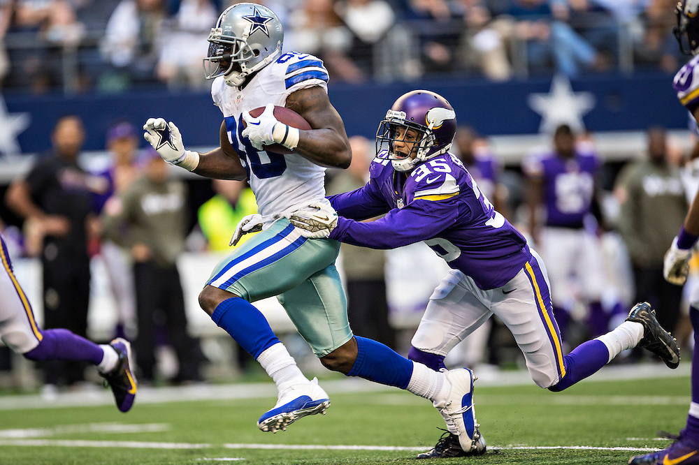 ARLINGTON, TX - NOVEMBER 3:  Dez Bryant #88 of the Dallas Cowboys is grabbed from behind by Marcus Sherels #35 of the Minnesota Vikings at AT&T Stadium on November 3, 2013 in Arlington, Texas.  The Cowboys defeated the Vikings 27-23.  (Photo by Wesley Hitt/Getty Images) *** Local Caption *** Dez Bryant; Marcus Sherels