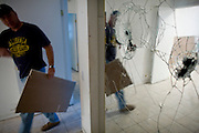 SACRAMENTO, CA - DECEMBER 2:   NorthWoods subcontractor Doug Joellenbeck walks past a vandalized mirror in a foreclosed home in Sacramento, California December 2, 2008. Many foreclosed homes need substantial repairs before going on the market. (Photo by Max Whittaker/Getty Images)
