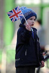 A young boy waves his Union Jack flag before Jenny Jones' arrival - Photo mandatory by-line: Dougie Allward/JMP - Tel: Mobile: 07966 386802 03/03/2014