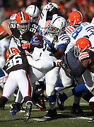 Indianapolis Colts running back Trent Richardson (34) gets stuffed by Cleveland Browns defensive back K'Waun Williams (36) and a group of defenders as he runs the ball in the first quarter during the NFL week 14 regular season football game against the Cleveland Browns on Sunday, Dec. 7, 2014 in Cleveland. The Colts won the game 25-24. ©Paul Anthony Spinelli