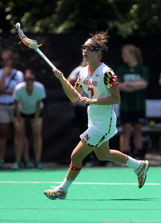 May 19, 2012; College Park, MD, USA; Maryland Terrapins midfielder Katie Schwarzmann (7) controls the ball against the Loyola Maryland Greyhounds in the second round NCAA Women's Lacrosse Tournament. Mandatory Credit: Brian Schneider-www.ebrianschneider.com