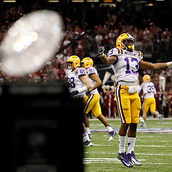 Jan 9, 2012; New Orleans, LA, USA; LSU Tigers cornerback Ron Brooks (13) reacts as The Coaches Trophy is seen in the foreground during the second half of the 2012 BCS National Championship game against the Alabama Crimson Tide at the Mercedes-Benz Superdome.  Mandatory Credit: Derick E. Hingle-US PRESSWIRE