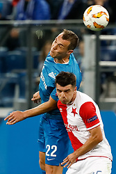 October 4, 2018 - Saint Petersburg, Russia - Artem Dzyuba (top) of FC Zenit Saint Petersburg and Ondrej Kudela of SK Slavia Prague vie for a header during the Group C match of the UEFA Europa League between FC Zenit Saint Petersburg and SK Sparta Prague at Saint Petersburg Stadium on October 4, 2018 in Saint Petersburg, Russia. (Credit Image: © Mike Kireev/NurPhoto/ZUMA Press)