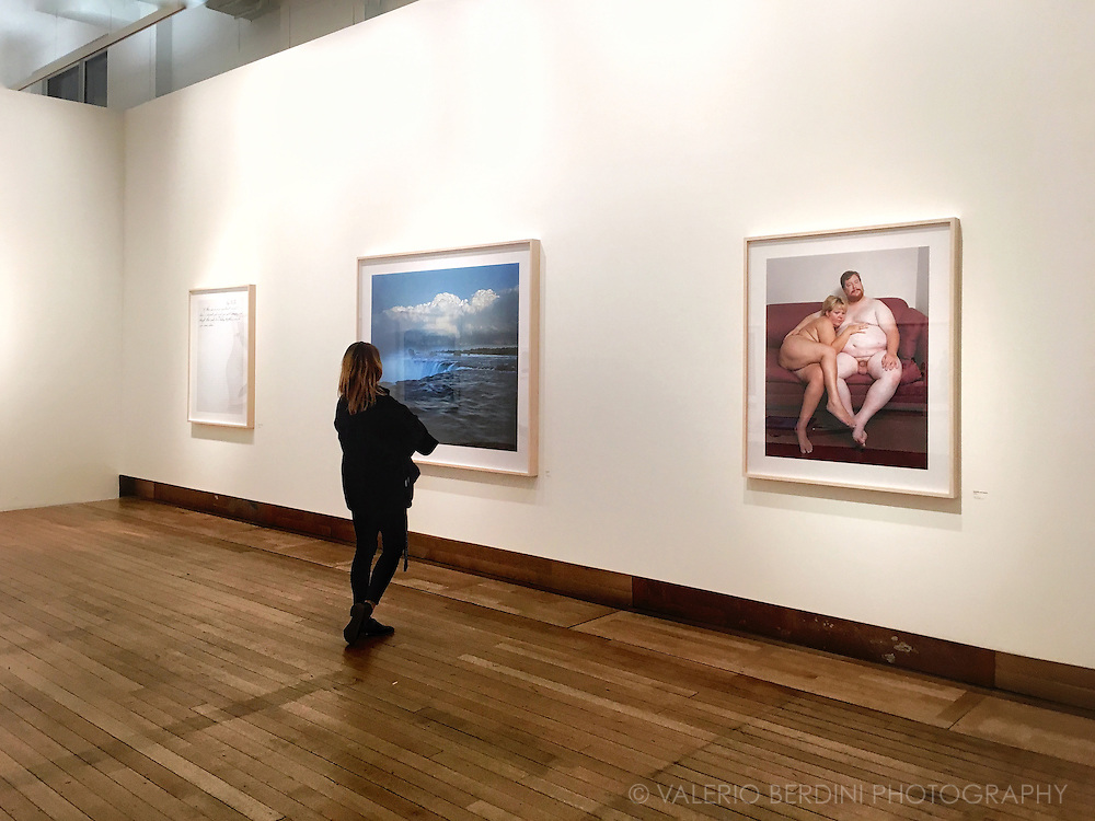 A lonely visitor at the gallery space of the Science Museum, in London, admiring a large print of Alec Soth's exhibition. This room shows my favourite of his works, Niagara, in a breath taking, large printed setting.