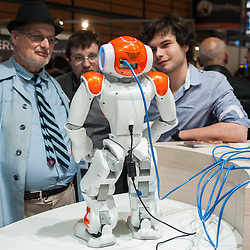 Lyon, France - 19 March 2014: NAO Robot by Aldebaran at Innorobo 2014, the 4th international trade show on service robotics.