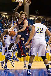 November 30, 2009; San Jose, CA, USA;  Saint Mary's Gaels guard Matthew Dellavedova (4) passes around San Jose State Spartans forward C.J. Webster (22) during the first half at the Event Center Arena.  Saint Mary's defeated San Jose State 78-71.