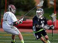 7 MAY 2009 -- CREVE COEUR, Mo. -- St. Louis University High School lacrosse player Ryan Reding (8) tries to slip past DeSmet Jesuit High School's Charlie Lauberth (11) during second half of the 7th annual Father Marco Cup at DeSmet in Creve Coeur, Mo. Saturday, May 7, 2011. SLUH topped DeSmet 13-10 in the annual game. Image © copyright 2011 Sid Hastings.