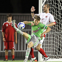 Rob Valentino (22) defends against Puerto Rico United Edivaldo DaSilva Jr. (10) during a United Soccer League Pro soccer match between Puerto Rico United and the Orlando City Lions at the Florida Citrus Bowl on April 22, 2011 in Orlando, Florida.  (AP Photo/Alex Menendez)