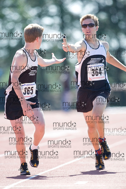 (Toronto, Ontario---3 August 2008)  Ciaran Callaghan (365) and  Michael Bourgeois (364)\ competing in the 4x800m relay at the 2008 OTFA Supermeet II, the Bantam, Midget, Youth Track and Field Championships. This image is copyright Sean W. Burges, and the photographer can be contacted at www.msievents.com.