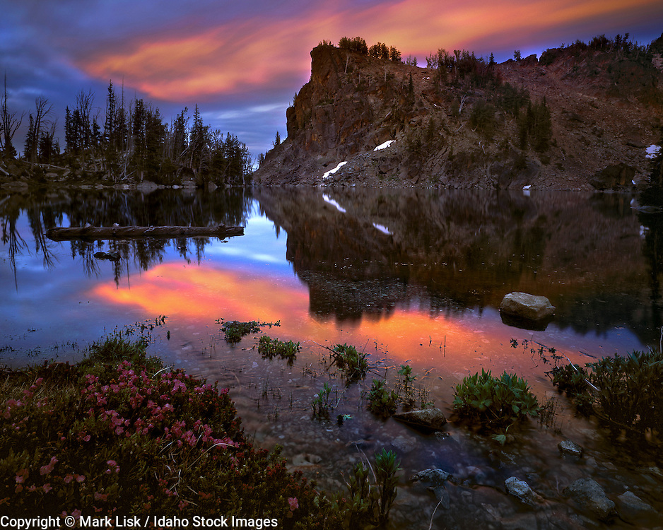 A pastel sky is reflected in Upper Cannon Lake in the Seven Devils Mtn. Range, a part of the Hells Canyon Rec. Area, ID.