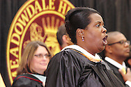 Tasha Millerton sings the Star Spangled Banner during the Meadowdale High School commencement in their gym in Dayton, Tuesday, May 22, 2012.