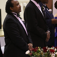 Community Service Award winner Charles Bouldin, left, stands for the Black American National Anthem Saturday at the MLK Banquet