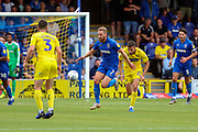 AFC Wimbledon midfielder Scott Wagstaff (7) dribbling during the EFL Sky Bet League 1 match between AFC Wimbledon and Wycombe Wanderers at the Cherry Red Records Stadium, Kingston, England on 31 August 2019.