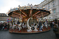 Roundabout at Christmas funfair in Rome Italy