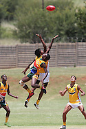 POTCHEFSTROOM, SOUTH AFRICA - JANUARY 28, 2 players jump for control of the ball during the AFL Game 1 match between the Flying Boomerangs and South African Lions under 18's at Mohadin Cricket Ground on January 28, 2013 in Potchefstroom, South Africa.Photo by Roger Sedres / Image SA