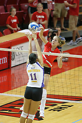 06 October 2007:  Amy Sampson reaches out to block a strike by M.C. Richmond. The Illinois State Redbirds pulled out a photo finish in a match that saw the 4th and 5th games extend into extra point play. Northern Iowa Panthers visited the Illinois State Redbirds at Redbird Arena on the campus of Illinois State University in Normal Illinois.