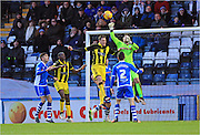 Josh Lillis punches clear during the Sky Bet League 1 match between Rochdale and Burton Albion at Spotland, Rochdale, England on 30 January 2016. Photo by Daniel Youngs.