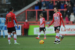 Exeter City's Tom Nichols and Exeter City's Graham Cummins prepare to kick off as Tranmere celebrate their goal - Photo mandatory by-line: Dougie Allward/JMP - Mobile: 07966 386802 - 31/01/2015 - SPORT - Football - Exeter - St James Park - Exeter City v Tranmere Rovers - Sky Bet League Two